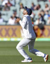 India's Mayank Agarwal catches out Australia's Marnus Labuschagne on the third day of their cricket test match at the Adelaide Oval in Adelaide, Australia, Saturday, Dec. 19, 2020. (AP Photo/David Mariuz)