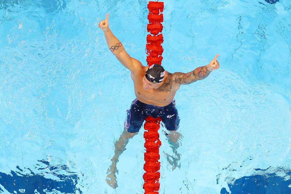 <p>TOKYO, JAPAN - JULY 29: Caeleb Dressel of Team United States celebrates after winning the gold medal and breaking the olympic record in the Men's 100m Freestyle Final on day six of the Tokyo 2020 Olympic Games at Tokyo Aquatics Centre on July 29, 2021 in Tokyo, Japan. (Photo by Rob Carr/Getty Images)</p>