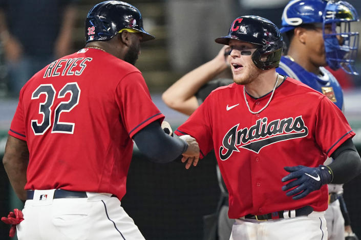 Cleveland Indians' Roberto Perez, right, and Franmil Reyes celebrate after Perez hit a three run home run in the eighth inning of a baseball game against the Kansas City Royals, Thursday, July 8, 2021, in Cleveland. (AP Photo/Tony Dejak)