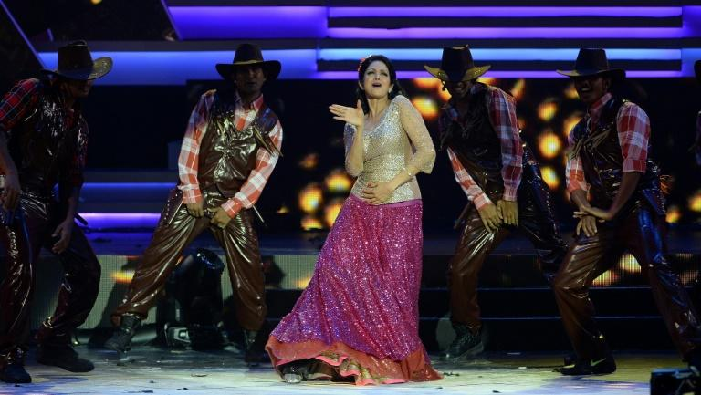 Photo taken in 2013 shows Sridevi (C) performing at the 14th International Indian Film Academy Awards