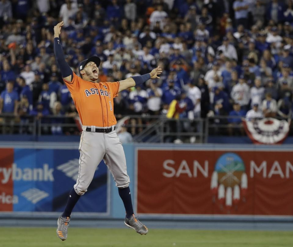 The Astros' Carlos Correa celebrates after Game 7 of the World Series. (AP)