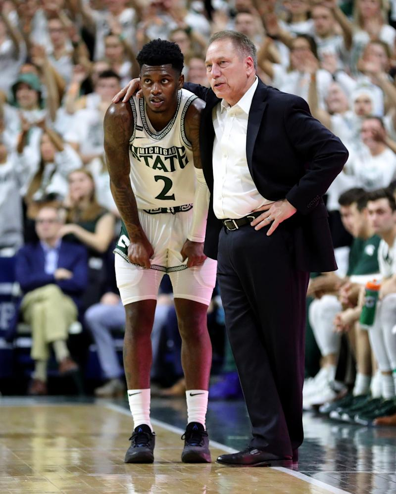 Michigan State coach Tom Izzo talks with guard Rocket Watts during the 80-69 win over Ohio State on Sunday, March 8, 2020, at the Breslin Center.
