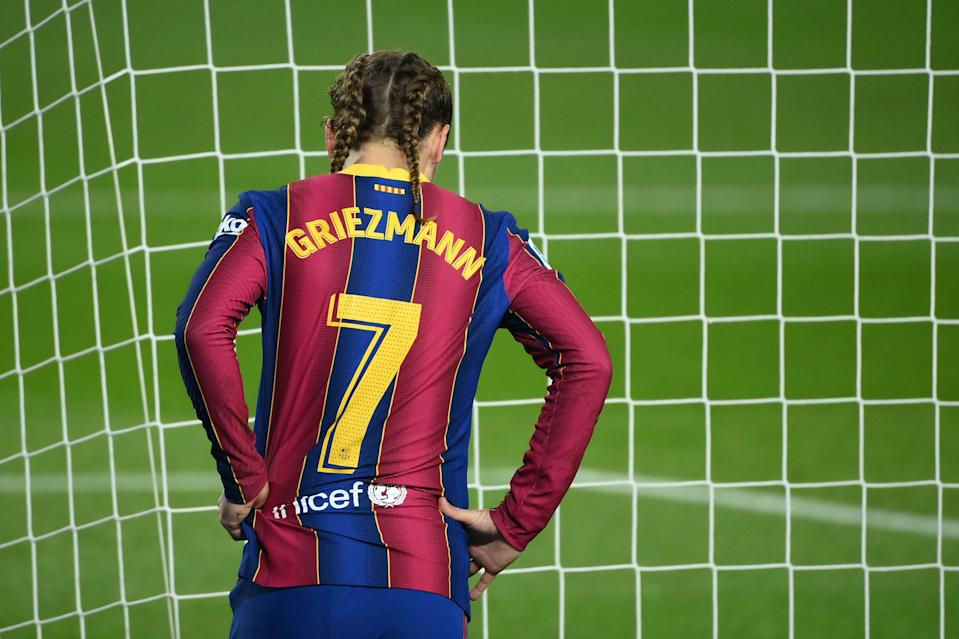 Barcelona's French midfielder Antoine Griezmann reacts to missing a goal opportunity during the Spanish league football match between FC Barcelona and Real Sociedad at the Camp Nou stadium in Barcelona on December 16, 2020. (Photo by LLUIS GENE / AFP) (Photo by LLUIS GENE/AFP via Getty Images)