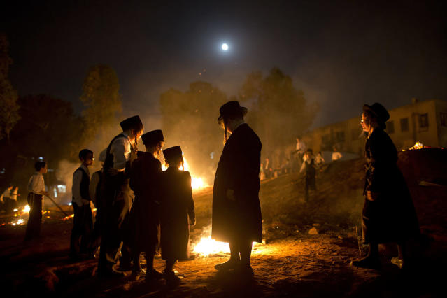 <p>Ultra-Orthodox Jews stand next to bonfires during Lag Ba'Omer celebrations, in Bnei Brak, Israel, Saturday, May 13, 2017. Jews celebrate Lag Ba'Omer to commemorate the end of a plague said to have decimated Jews in Roman times. (Photo: Oded Balilty/AP) </p>