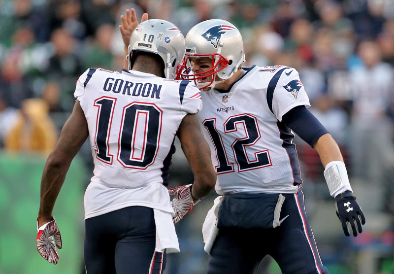 EAST RUTHERFORD, NJ. - NOVEMBER 25: Josh Gordon of the New England Patriots is congratulated by Tom Brady after they connected for a 17 yard first down catch during the 4th quarter of the game at MetLife Stadium on November 25, 2018 in East Rutherford, New Jersey. (Staff Photo By Nancy Lane/MediaNews Group/Boston Herald via Getty Images)