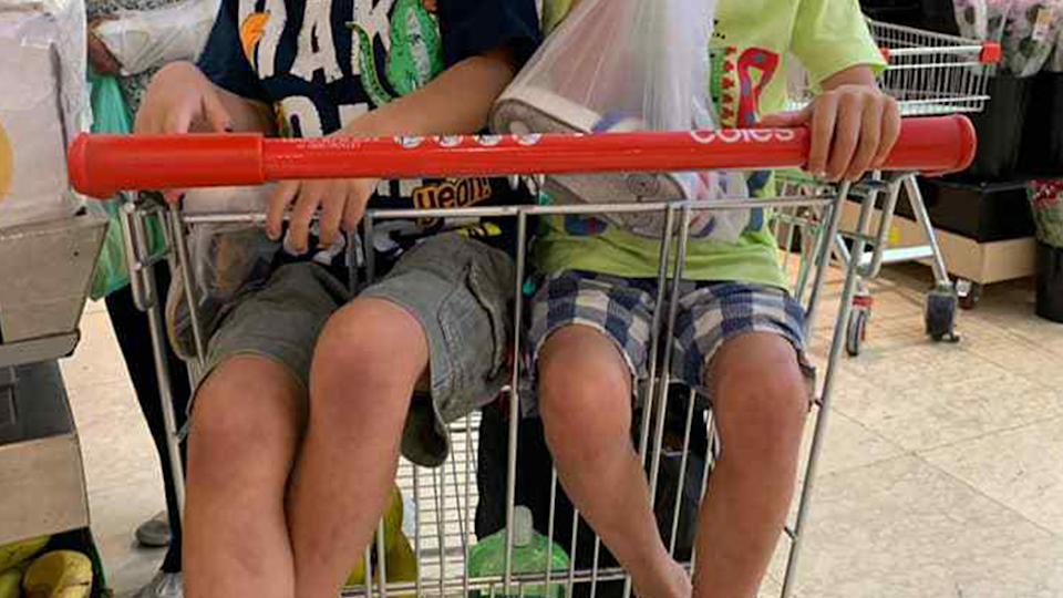 A Sydney mum was told it was 'illegal' to have her children sitting side-by-side in a Coles trolley.
