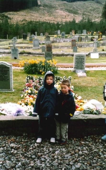 Andrew and his brother at the graveside