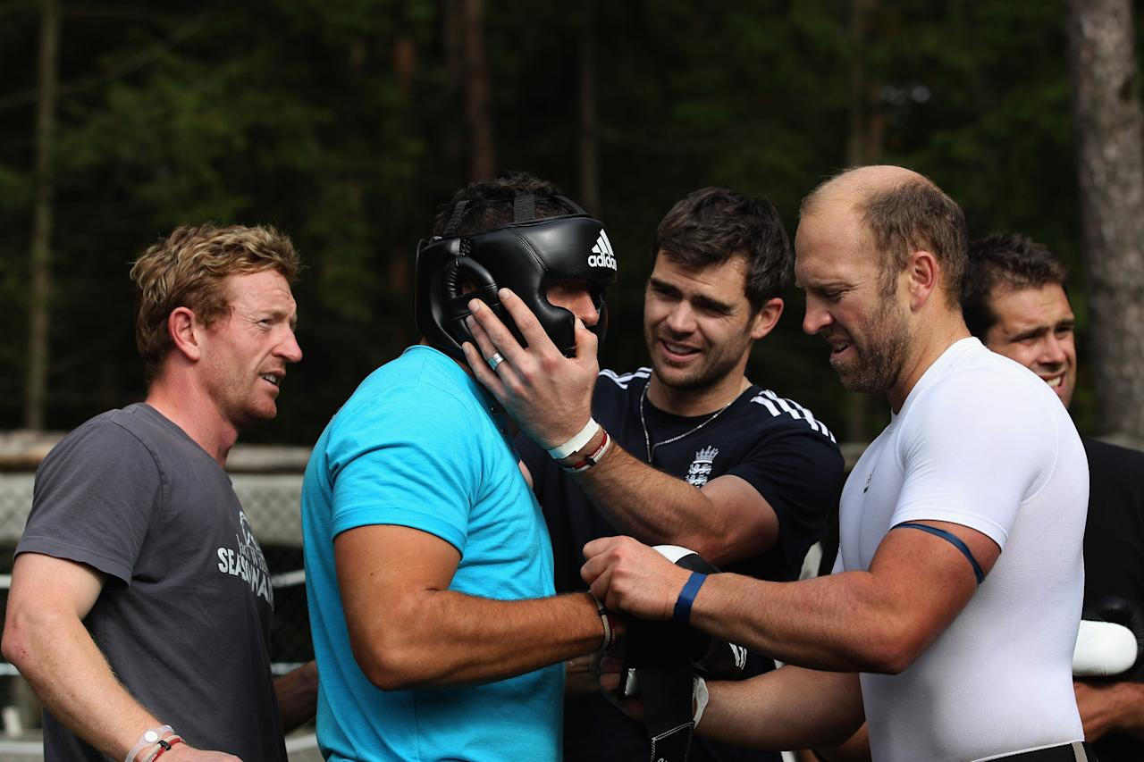 NUREMBERG, GERMANY - SEPTEMBER 26:  England player Tim Bresnan is helped prepare by team mates before doing battle in the final of a boxing excercise during the England Cricket squad Pre Ashes Training Camp on September 26, 2010 near Nuremberg, Germany.  (Photo by Stu Forster/Getty Images)