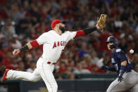 Los Angeles Angels' Kaleb Cowart misses a ground ball hit by Seattle Mariners' Kristopher Negron as Mariners' Ryon Healy, background right, runs to third base during the sixth inning of a baseball game, Saturday, Sept. 15, 2018, in Anaheim, Calif. Healy scored on the play. (AP Photo/Jae C. Hong)