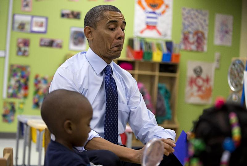 President Barack Obama reacts as he draws a card during a learning game during a visit to a pre-kindergarten classroom at College Heights Early Childhood Learning Center in Decatur, Ga., Thursday, Feb. 14, 2013.  The president is traveling to promote his economic and educational plan that he highlighted in his State of the Union address. (AP Photo/ Evan Vucci)