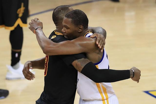 """LeBron James and <a class=""""link rapid-noclick-resp"""" href=""""/nba/players/4244/"""" data-ylk=""""slk:Kevin Durant"""">Kevin Durant</a> embrace after the Warriors' title-clinching Game 5 win. (Getty Images)"""