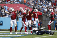 Arizona Cardinals defensive end J.J. Watt (99) celebrates after teammate Corey Peters, third from left, recovered a Tennessee Titans fumble in the first half of an NFL football game Sunday, Sept. 12, 2021, in Nashville, Tenn. (AP Photo/Wade Payne)