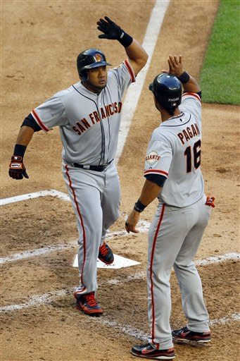 San Francisco Giants' Melky Cabrera celebrates his two-run home run with Angel Pagan (16) during the fifth inning of an opening day baseball game against the Arizona Diamondbacks, Friday, April 6, 2012, in Phoenix. (AP Photo/Matt York)