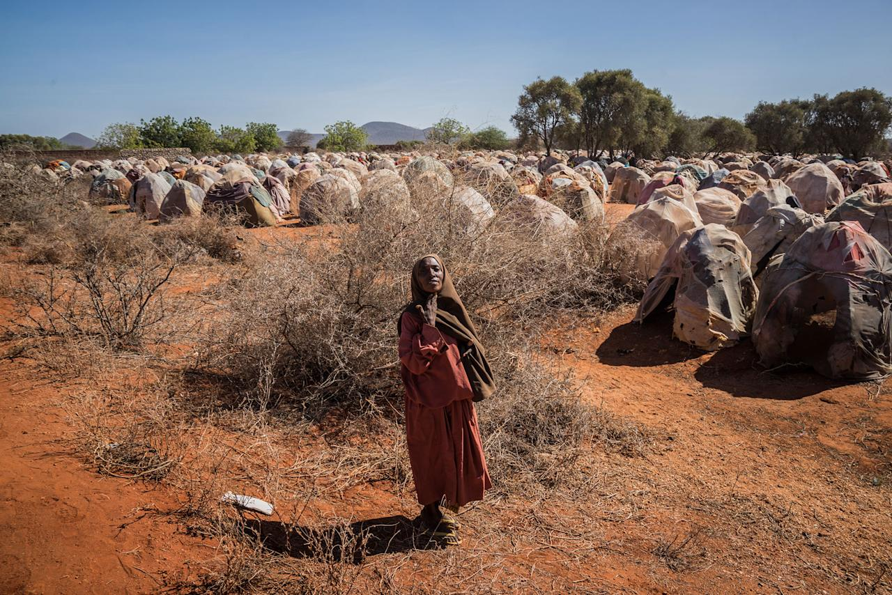 <p>An elderly woman begs for food at an Internally Displaced Persons camp on the outskirts of Dinsor, Somalia, March 8, 2017. Somalia is in the grip of an intense drought, induced by consecutive seasons of poor rainfall. The country is on the brink of a famine, just six years after another famine led to the loss of a quarter of a million lives. In the worst-affected areas, inadequate rainfall and lack of water have wiped out crops and killed livestock, leaving half the population (6.2 million people) in need of humanitarian assistance. Nearly 3 million of these people cannot meet their daily food requirements. Over a quarter of a million people fled their homes between November 2016 and the end of February 2017. More than 11,000 cases of acute watery diarrhea (AWD)/cholera have been reported, including 268 related deaths, as drought conditions worsen across the country. (Photo: Giles Clarke/Getty Images) </p>