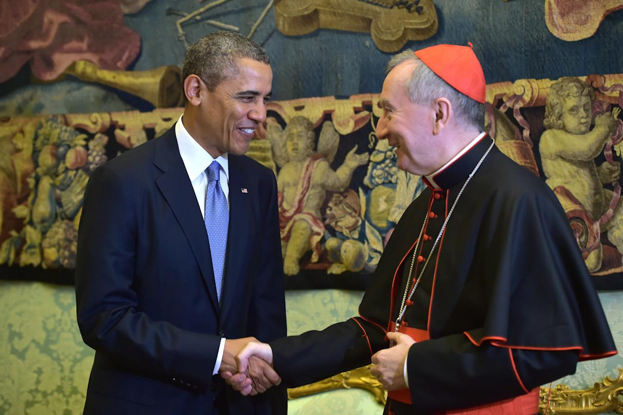 Vatican secretary of state Cardinal Pietro Parolin shakes hands with President Barack Obama, at the Vatican Thursday, March 27, 2014. A visibly energized President Barack Obama held a nearly hourlong audience with Pope Francis at the Vatican on Thursday, expressing his great admiration for the pontiff and inviting him to visit the White House. Although Obama and the church remain deeply split over abortion and contraception, Obama considers the pontiff a kindred spirit on issues of economic inequality, and their private meeting in the Papal Library ran longer than scheduled. (AP Photo/Gabriel Bouys, Pool)