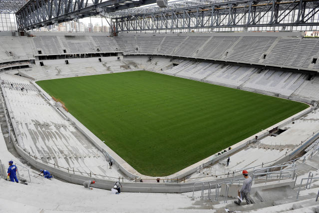 Arena da Baixada continues under construction in Curitiba, Brazil, Tuesday, Feb. 18, 2014. The southern Brazilian city will host matches during this year's World Cup despite serious problems in the renovation of its stadium that put it on the brink of becoming the first venue ever to be kicked out because of delays, FIFA Secretary General Jerome Valcke said Tuesday. (AP Photo/Denis Ferreira Netto)