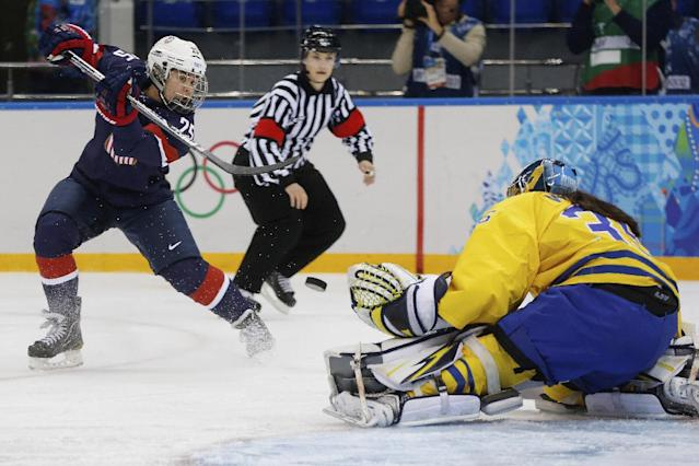 Alex Carpenter of the United States shots on goalkeeper Valentina Wallner of Sweden during the first period of the 2014 Winter Olympics women's semifinal ice hockey game at Shayba Arena Monday, Feb. 17, 2014, in Sochi, Russia. (AP Photo/Petr David Josek)