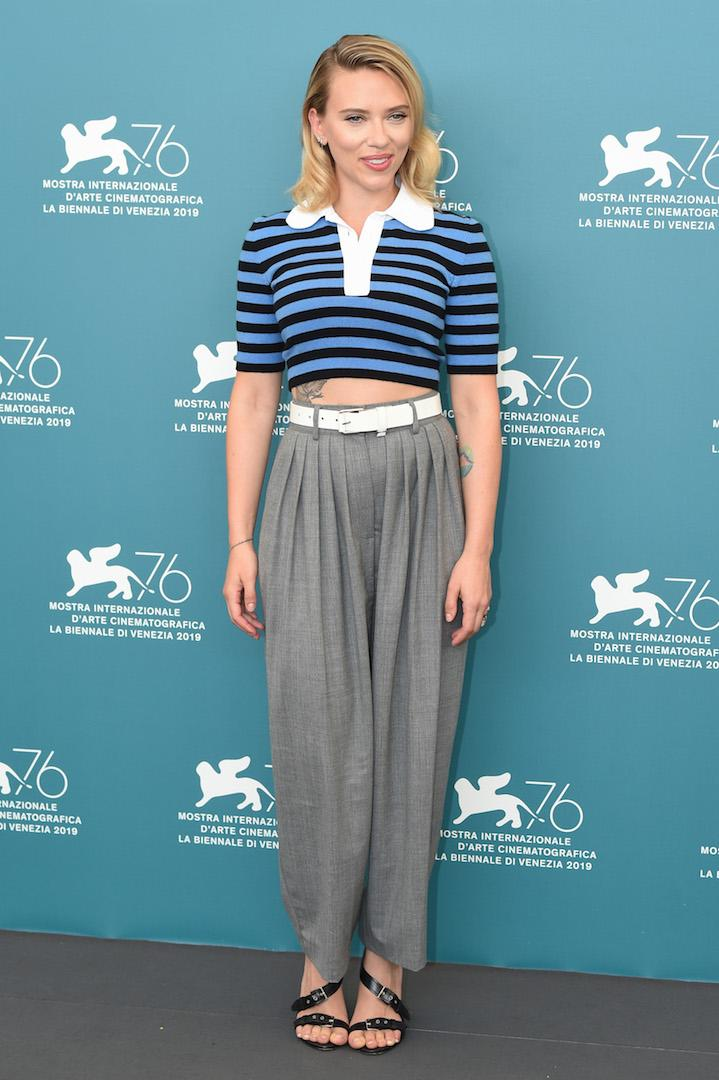 Proving you don't need a frock to walk the red carpet, actress Scarlett Johansson opted for a cropped polo shirt and tailored trousers at the 2019 Venice Film Festival. <em>[Photo: Getty]</em>