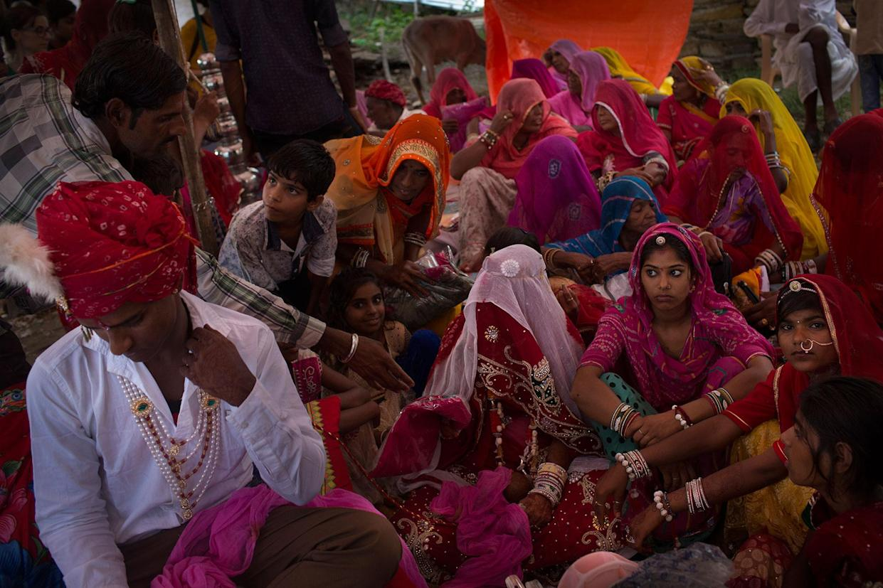 A wedding in a small village near Udaipur, Rajasthan, India in July 2016. The groom says to be 18 years old and the bride 22. A relative says later that she is younger than he. Some families lie about the age of the girls because they are afraid of the government's actions. Some of these girls don't have a birth certificate, so it is easier for the families to get away with it. (Photo: Rafael Fabrés)