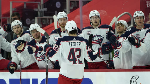 Columbus Blue Jackets center Alexandre Texier (42) celebrates his goal against the Detroit Red Wings in the third period of an NHL hockey game Monday, Jan. 18, 2021, in Detroit. (AP Photo/Paul Sancya)