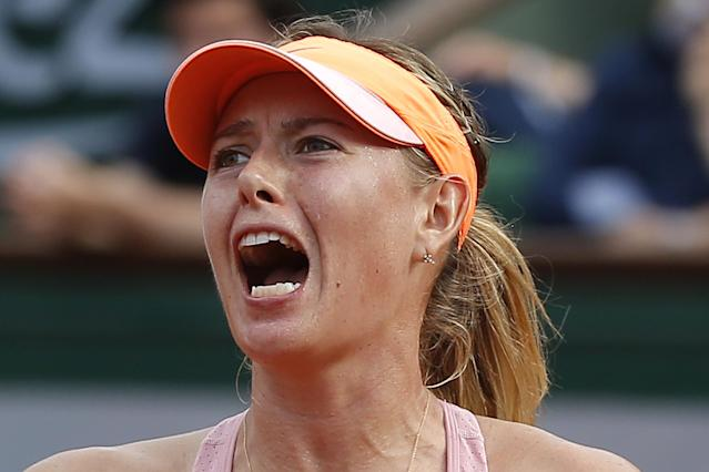 Russia's Maria Sharapova reacts as she plays Romania's Simona Halep during their final match of the French Open tennis tournament at the Roland Garros stadium, in Paris, France, Saturday, June 7, 2014. (AP Photo/Michel Euler)