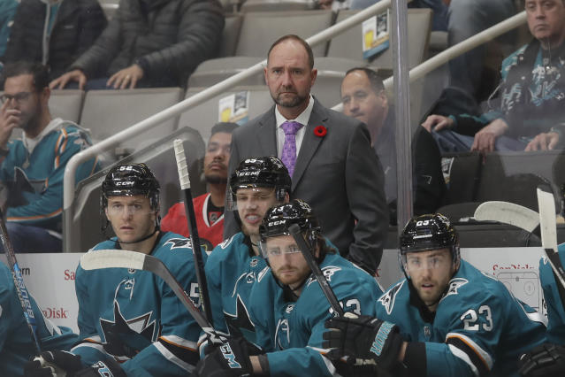 San Jose Sharks head coach Peter DeBoer, center, watches against the Chicago Blackhawks during an NHL hockey game in San Jose, Calif., Tuesday, Nov. 5, 2019. (AP Photo/Jeff Chiu)