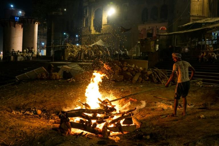 """For centuries, the Doms have provided the ceremonial flame used to cremate the dead brought to Varanasi for """"moksha"""", or release from the Hindu life cycles"""
