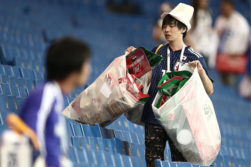 <p>Japan's supporter collecting rubbish after their 2018 FIFA World Cup Round of 16 football match against Belgium at Rostov Arena Stadium. Team Belgium won the game 3:2. Valery Sharifulin/TASS (Photo by Valery Sharifulin\TASS via Getty Images) </p>