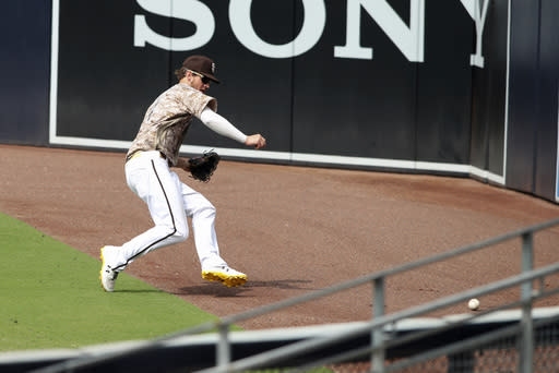 San Diego Padres fielder Wil Myers tracks down a ball hit to the right field corner by San Francisco Giants Brandon Crawford in the fifth inning of a baseball game Sunday, Sept. 13, 2020, in San Diego. (AP Photo/Derrick Tuskan)