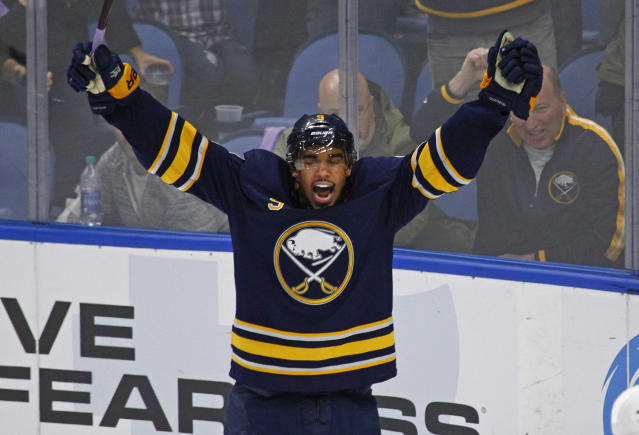 "Leaving the <a class=""link rapid-noclick-resp"" href=""/nhl/teams/buf/"" data-ylk=""slk:Buffalo Sabres"">Buffalo Sabres</a> is a more-than-valid reason to celebrate. (AP Photo/Jeffrey T. Barnes)"
