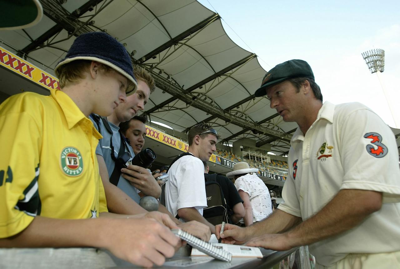 BRISBANE- AUSTRALIA - DECEMBER 8: Australian captain Steve Waugh signs autographs after playing his last test match at the Gabba on day five of the first test between Australia and India played at the Gabba, December 8, 2003 in Brisbane, Australia.  (Photo by Chris McGrath/Getty Images)