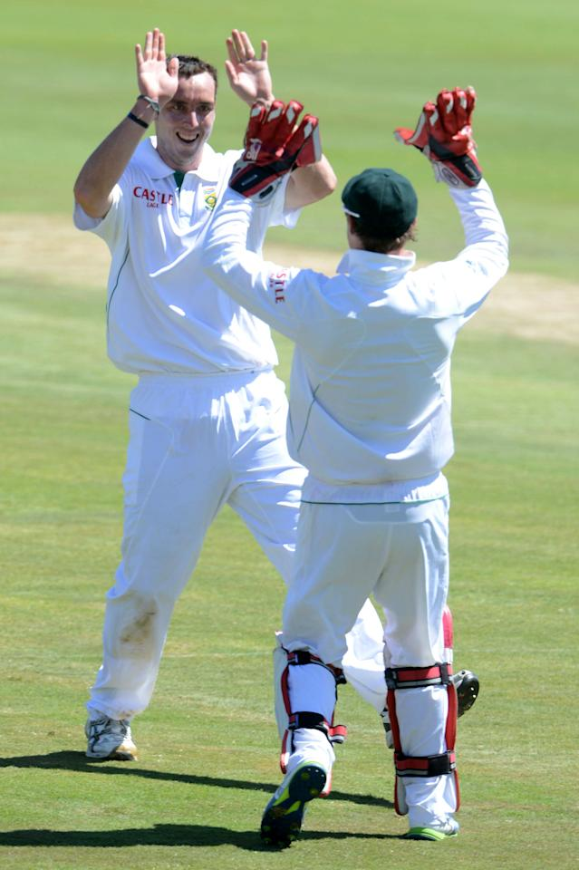 PRETORIA, SOUTH AFRICA - FEBRUARY 23: Kyle Abbott of South Africa celebrates his first test wicket of Mohammad Hafeez of Pakistan with AB de Villiers of South Africa  during day 2 of the 3rd Test match between South Africa and Pakistan at SuperSport Park on February 23, 2013 in Pretoria, South Africa, (Photo by Lee Warren / Gallo Images/Getty Images)