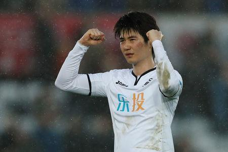 Soccer Football - Premier League - Swansea City vs Burnley - Liberty Stadium, Swansea, Britain - February 10, 2018 Swansea City's Ki Sung Yueng celebrates after the match Action Images via Reuters/Andrew Boyers