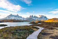 "Traveling to Patagonia is, essentially, a voyage to the ends of the earth. You'll need to first connect through a South American hub, like the tango capital of <a href=""https://www.cntraveler.com/destinations/buenosaires?mbid=synd_yahoo_rss"" rel=""nofollow noopener"" target=""_blank"" data-ylk=""slk:Buenos Aires"" class=""link rapid-noclick-resp"">Buenos Aires</a> or metropolitan Santiago, Chile—arguably warranting a few days of their own—before you reach the alpine lakes and glaciers of Patagonia. Explore Torres del Paine National Park, one of <a href=""https://www.cntraveler.com/gallery/most-beautiful-places-in-chile?mbid=synd_yahoo_rss"" rel=""nofollow noopener"" target=""_blank"" data-ylk=""slk:Chile"" class=""link rapid-noclick-resp"">Chile</a>'s most iconic landscapes, and hang with Magellanic penguins at the Otway Sound, on the way to Puerto Natales (also in Chile). Or, listen to the cracks of Argentina's Perito Moreno Glacier, which is constantly moving. Plan ahead to hit it all, with stays in world-class lodges like <a href=""https://www.cntraveler.com/hotels/chile/torres-del-paine-national-park/hotel-salto-chico-explora-patagonia-torres-del-paine-national-park?mbid=synd_yahoo_rss"" rel=""nofollow noopener"" target=""_blank"" data-ylk=""slk:Explora Patagonia."" class=""link rapid-noclick-resp"">Explora Patagonia.</a>"