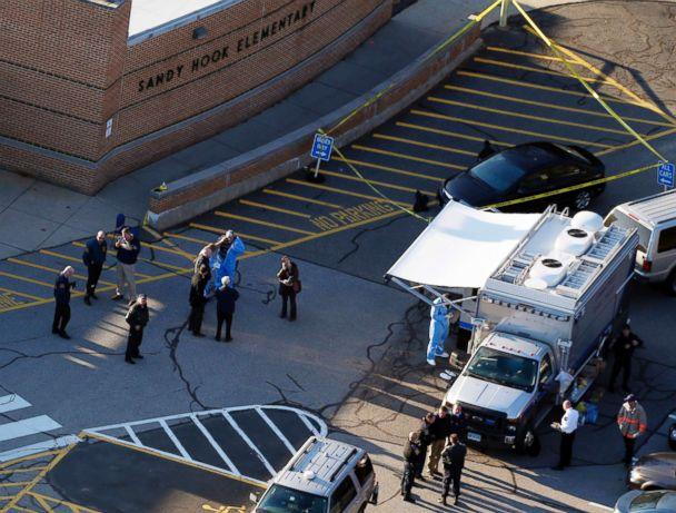 PHOTO: Officials are on the scene outside of Sandy Hook Elementary School in Newtown, Conn., where authorities say a gunman opened fire inside an elementary school in a shooting that left 27 people dead, including 20 children, Dec. 14, 2012. (Julio Cortez/AP, FILE)