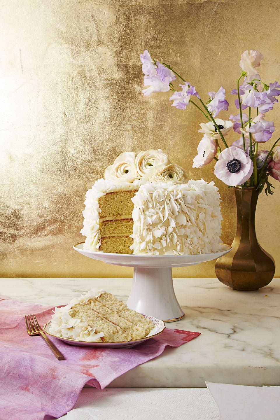 """<p>Three layers + creamy frosting = Mom's dream come true.</p><p><em><a href=""""https://www.goodhousekeeping.com/food-recipes/a37460/coconut-layer-cake-with-cream-cheese-frosting-recipe/"""" rel=""""nofollow noopener"""" target=""""_blank"""" data-ylk=""""slk:Get the recipe for Coconut Layer Cake with Cream Cheese Frosting »"""" class=""""link rapid-noclick-resp"""">Get the recipe for Coconut Layer Cake with Cream Cheese Frosting »</a><strong><br></strong></em></p><p><strong>RELATED:</strong> <a href=""""https://www.goodhousekeeping.com/holidays/mothers-day/g4283/mothers-day-activities/"""" rel=""""nofollow noopener"""" target=""""_blank"""" data-ylk=""""slk:35 Fun and Creative Mother's Day Activities"""" class=""""link rapid-noclick-resp"""">35 Fun and Creative Mother's Day Activities</a><em><br></em></p>"""