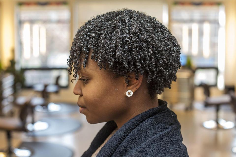 <p>In order to distribute the product throughout the hair, rinse the entire head with a splash of water. Then, bend over and shake furiously. This will help separate curls, and each hair will fall naturally into place when you flip back over. Sit under a hood dryer until hair is completely dry (about 30 minutes).</p>