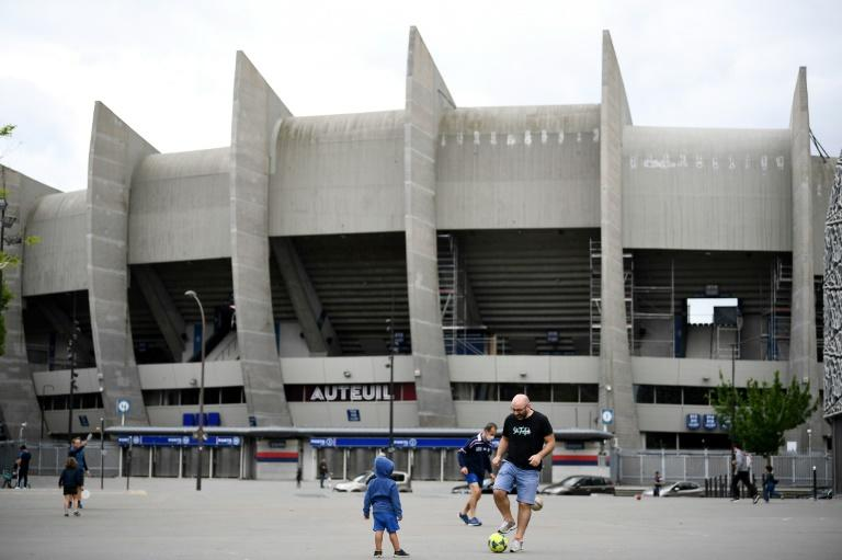 Children play football outside PSG's Parc des Princes home during the lockdown in France in April (AFP Photo/FRANCK FIFE)