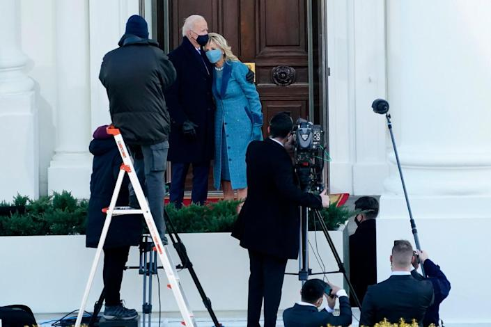 President Joe Biden and his wife Jill Biden pause outside the White House during the Presidential Escort, part of Inauguration Day ceremonies, on Jan. 20, 2021, in Washington.