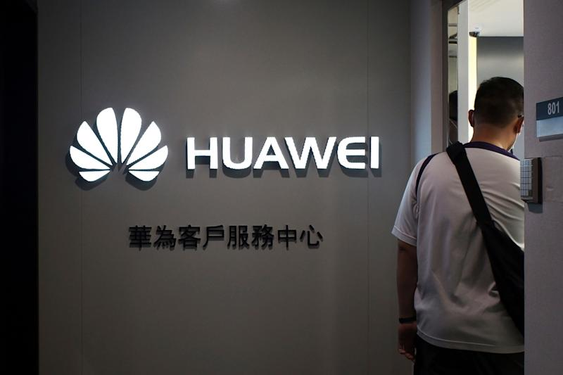 A man walks inside a Huawei's customer service center in Hong Kong, Friday, March 29, 2019. (Photo: Kin Cheung/AP)