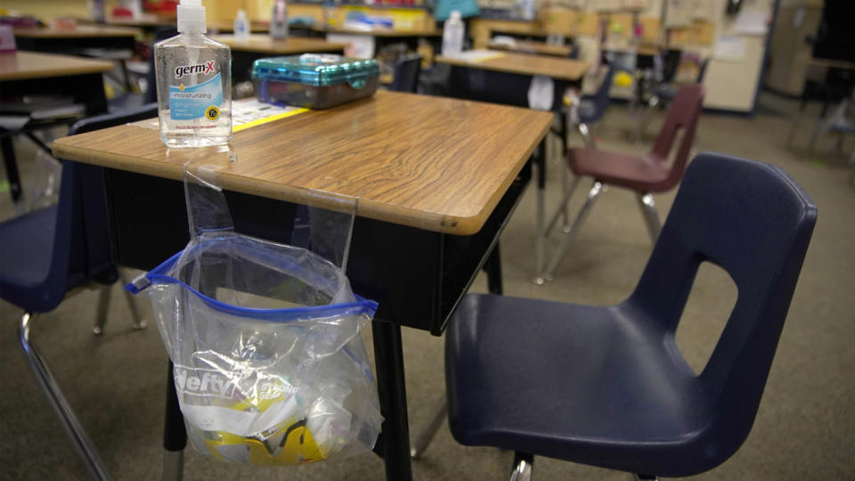 A teacher prepares her classroom before students arrive for school at Freedom Preparatory Academy on February 10, 2021 in Provo, Utah. (George Frey/Getty Images)