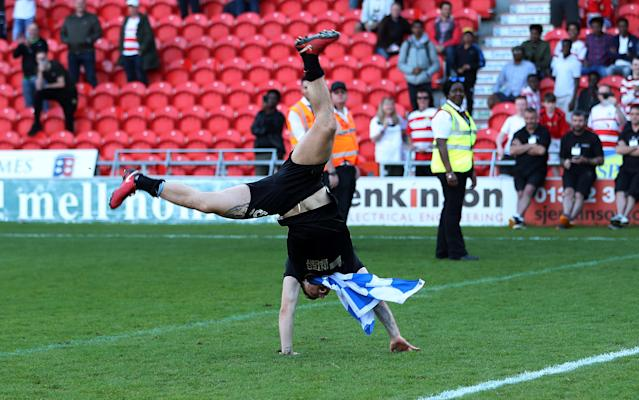 """Soccer Football - League One - Doncaster Rovers vs Wigan Athletic - Keepmoat Stadium, Doncaster, Britain - May 5, 2018 Wigan Athletic's Max Power celebrates after winning League One Action Images/John Clifton EDITORIAL USE ONLY. No use with unauthorized audio, video, data, fixture lists, club/league logos or """"live"""" services. Online in-match use limited to 75 images, no video emulation. No use in betting, games or single club/league/player publications. Please contact your account representative for further details."""
