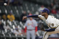 Milwaukee Brewers' Freddy Peralta pitches during the first inning of the team's baseball game against the St. Louis Cardinals on Tuesday, May 11, 2021, in Milwaukee. (AP Photo/Aaron Gash)