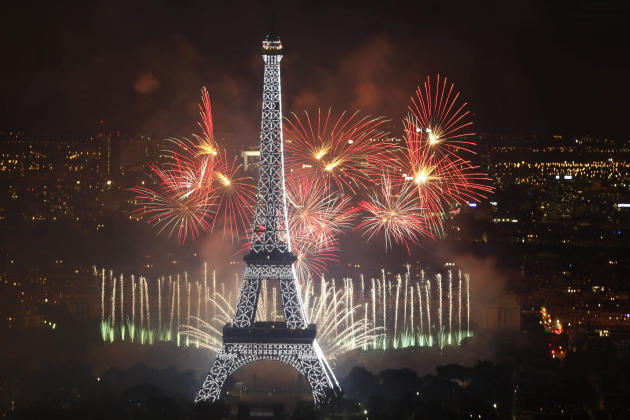 Fireworks illuminate the Eiffel Tower in Paris during Bastille Day celebrations late Thursday, July 14, 2011. (AP Photo/Thibault Camus)