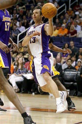 Phoneix Suns' Steve Nash drives against the Los Angeles Lakers during the second half of an NBA basketball game, Saturday, April 7, 2012, in Phoenix. (AP Photo/Matt York)