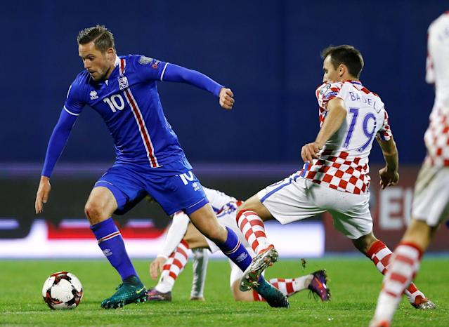 FILE PHOTO: Football Soccer - Croatia vs Iceland - 2018 World Cup Qualifying European Zone - Maksimir arena, Zagreb, Croatia - 12/11/16 Croatia's Milan Badelj and Iceland's Gylfi Sigurdsson in action REUTERS/Antonio Bronic /File Photo