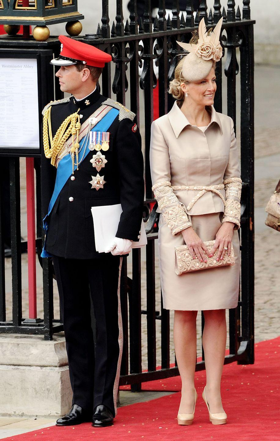 """<p>Sophie chose a neutral look for <a href=""""https://www.townandcountrymag.com/the-scene/weddings/g20052313/kate-middleton-prince-william-royal-wedding-2011-photos/"""" rel=""""nofollow noopener"""" target=""""_blank"""" data-ylk=""""slk:Will and Kate's royal wedding in 2011."""" class=""""link rapid-noclick-resp"""">Will and Kate's royal wedding in 2011. </a> Here she is alongside Prince Edward, who looked quite dashing in his military uniform for the big day.</p>"""