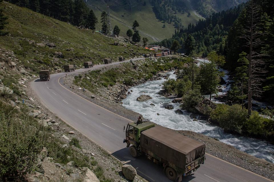 "An Indian army convoy drives toward Leh, on a highway bordering China, in Gagangir, India, on Sept. 2.<span class=""copyright"">Yawar Nazir—Getty Images</span>"