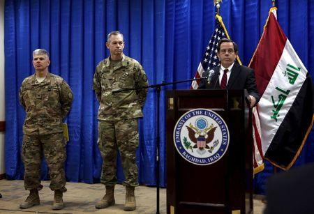 U.S. Ambassador to Iraq Jones introduces Lt. Gen. MacFarland as new commander general of U.S.-led coalition in Iraq and Col. Warren as coalition's new spokesman during news conference in Baghdad