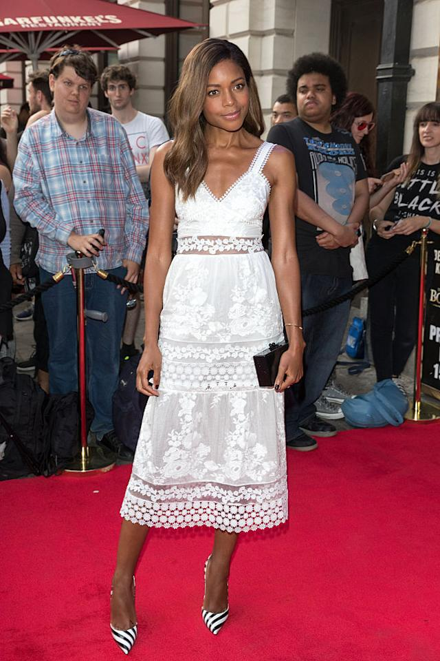 <p>The red carpet darling brings some drama to this girly and delicate Self Portrait frock in the form of striped shoes and a lucite clutch.<i> (Photo by Luca Teuchmann/WireImage)</i><br /></p>